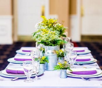 bright greenery and purple table display
